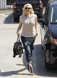 Gwen Stefani wears a plain white tee with her overalls