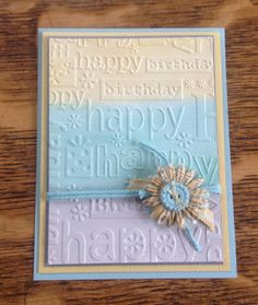 Great idea to water color the paper before embossing! By Sue's Stamping Station
