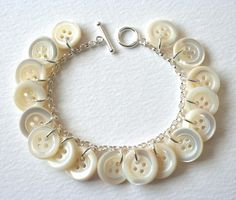 Super-pretty button bracelet... lots of color schemes in the Etsy shop: http://www.etsy.com/listing/70959466/sterling-silver-and-antique-mother-of