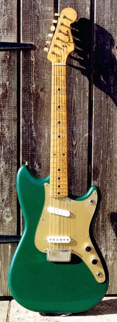 '58 Duo Sonic - refinished - I do like the lucite pickguard sprayed gold on the underside - pretty genius idea.
