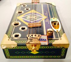 Winston and Fidel cigar box guitars by Mark Kost