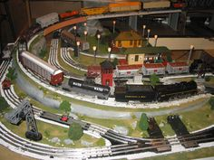 Toy train collectors are an interesting a varied group of individuals. Some of them spend the better part of life, looking for the perfect train set creating. Lionel Trains Layout, Model Trains, Toy Trains, Third Rail, Train Table, Christmas Train, Outdoor Toys, Train Layouts, Train Set