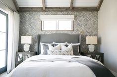 Amazing Herringbone focal point wall in this bedroom!  Gray and white with rustic touches.  Marigold | Brooke Wagner Design