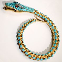 Victorian snake bracelet with cabochon turquoise beads set in 18 karat gold.