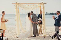 I love the beach wedding arch! So cute!