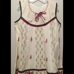 Indian Style Dress NWOT Sleeveless Indian style dress. Stops at the knee. Small scoop neck-line with a bow. Flares at the waist. Great summer dress! More on the modest side. Indian Dresses Midi