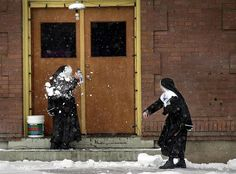 Sister Rosa Elena, right, hits Sister Amanda de Jesus with a snowball after class Jan. 22 at Mount St. Michael's Seminary in Spokane, Wash. The two nuns, visiting from Mexico, said it was the first time they had ever seen snow