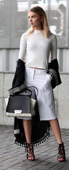 Black & white chic: Bermudas pants, fringed coat.