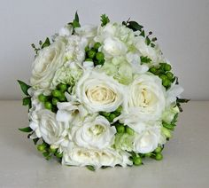 Bouquet of rose,freesia,lisianthus,hypericum berry and a touch of ...