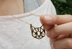 This modern geometric cat face pendant from Glorikami will definitely make a statement about your love of cats and design. Created to look like an origami cat, each piece is handcrafted from gold plated brass and comes with a gold chain. Made in Thailand. $13.58 US from the Glorikami Etsy shop.