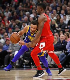 Stephen Curry of the Golden State Warriors tries to move against David Nwaba of the Chicago Bulls at the United Center on January 17 2018 in Chicago...
