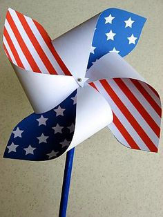 Make your own patriotic pinwheels.  She attaches the printable template to print out -- then just cut, fold and attach (use a bead spacer for better spinning).