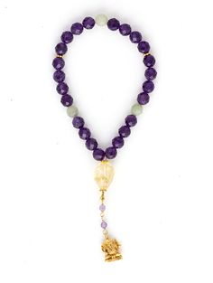 This 27-bead Amethyst, Jade, and Citrine wrist mala includes a gold vermeil pendant of the Hindu deity, Ganesh.
