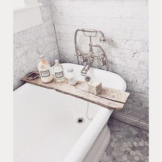 """""""We left the original vintage French barn door hardware on the boards. Tub is from @vintagebath_losaltos faucet from @rohlfaucets and French bath and body…"""""""