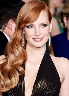 Jessica Chastain's cascading waves and smoldering smoky bronze eye makeup