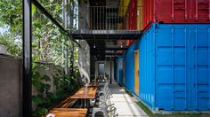 Stacked shipping containers house bedrooms at #Vietnam #hostel by TAK Architects — #Architecture via @dezeen