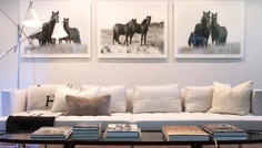 Love the long white couch and black & white artwork.