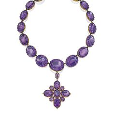 GOLD AND AMETHYST PENDANT-NECKLACE The antique-style pendant necklace suspending a navette-shaped pendant, set throughout with 23 oval-shaped amethysts and four pear-shaped amethysts weighing a total of approximately 475.00 carats, length 15½ inches, circa 1830; pendant detachable.