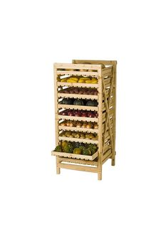 "Years ago, people stored ""keeper"" crops such as apples, winter squash, onions and potatoes on rustic wooden racks like this one. The drawers are slatted to ensure good air circulation, and they slide out for easy access. For best results, the rack should be located in a cool, dark cellar or shed."