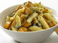"""Butternut Squash Penne.  Rich Gruyere cheese complements the sweet roasted squash.    Recipe courtesy of """"The Illustrated Kitchen Bible: 1,000 Family Recipes from Around the World"""" by Victoria Blashford-Snell."""
