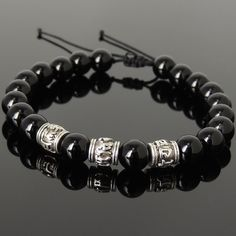 """Zen Yoga Meditation Healing Bracelet Protection, Spiritual, Grounding, Chakras, & Awareness - Handmade Adjustable Gemstone Bracelet - Made for Men & Women / All Genders - 8mm Natural Bright Black Onyx - No Lead & Nickle Tibetan Silver OM Buddhism Beads - Strong Chinese Braided Cords - FREE Silver Polishing Cloth Drawstring adjustable Fits wrist size from 6.5""""/16.51cm to 8""""/20.32cm (adjustable to fit larger wrists) Here is how to measure your wrist *We go by wrist size and not the length of…"""