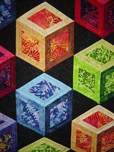 Elisa Lawrance chose brilliant Southwest batiks for this open tumbling block quilt