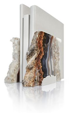 FIM Bookends:The gems are natural outgrowths from the inside of ancient lava streams, with traces of crystal, agate and amethyst. The organic design of their hand-polished bases was inspired by the natural patterns in the rock