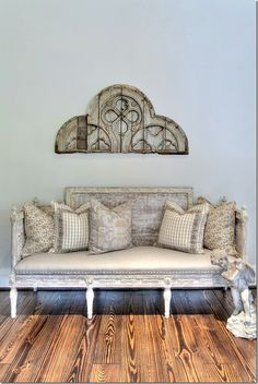 I like the middle pillow. Frame a large image w/ coordinating edging. Note the different sized prints in this collection.