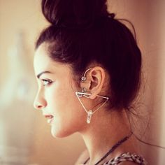 Pamela Love Vine Ear Cuff and ManiaMania Concert earrings.