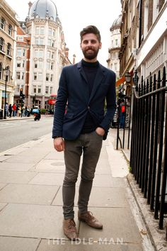 Men's Street Style | Layer Up - Layered up polo neck under smart blazer for a more paired back style, team with grey jeans and tan leather shoes to break up the block of navy. | Shop the look at The Idle Man