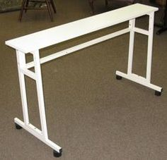This item is back in stock! Many improvements, including a stronger tray (not shown) that fits at the back of the table. Now includes an adjustable front support brace. Excellent stability, knitting doesn't catch on this table and it's suitable for Japanese style knitting machines, and plastic bed machines. If you find a better price, let us know! store.dknits.com