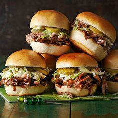 Balsamic Vinegar and Honey Pulled Pork Sliders~ Fresh coleslaw and dill pickles give these mini barbecue pork sandwiches a bright crunch in every bite. Add a squirt of Dijon-style mustard for tang and a spoonful of honey to sweeten things up.  /  bhg.com