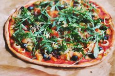 Super crunchy vegan Pizza with Rucola and Antipasti