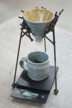 "No.1 of the ""Lines"" series. Hand crafted metal pour over stand with ceramic ware to brew coffee."