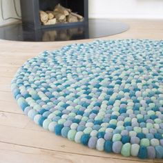 Blue felt ball design!  Se more in one of our websites:  Felt ball rug: http://unaliving.com  Kugletæppe: http://unaliving.dk  Filzkugelteppich: http://unaliving.de    We have 14 different designs, all made of wool!