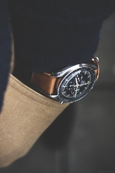 Positively Humble - Omega Speedmaster. A classic, but for a more affordable alternative try http://watchhomage.com/category/omega-speedmaster-homages/