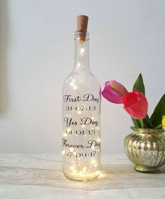 Wedding day gift, wine light bottle, message on a bottle, gay wedding, fairy lights bottle, wine lover, wedding decor, wedding table decor by handmadebydebmac on Etsy https://www.etsy.com/uk/listing/516716859/wedding-day-gift-wine-light-bottle