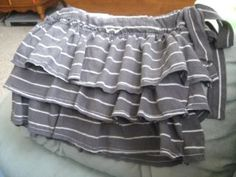 This is a girl's skirt made from a man's polo shirt.  I can't wait to try it out with some of David's old polos.
