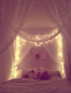 We can make this DIY bed canopy with curtain rods, sheer fabric, and christmas lights. (That is, when I get my own room again and don't have a bunk bed.)
