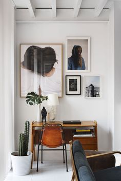 Small spaces look cozy with a cluster of wall hangings, small desk, groovy chair.  Don't forget the plants!