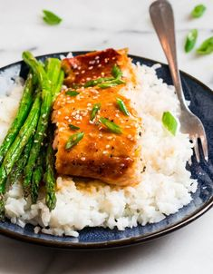 Serve your easy Baked Teriyaki Salmon with rice and asparagus for a healthy meal the entire family will love! The sticky and sweet glaze will please even the most picky of eaters! Salmon And Rice, Salmon And Asparagus, Asparagus Recipe, Healthy Salmon Recipes, Fish Recipes, Seafood Recipes, Healthy Foods, Recipies, Salmon Fish Recipe