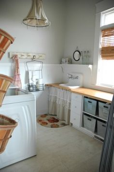 Very cute and quaint laundry room.