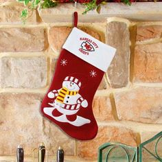 """$18.53-$28.00 Each Snowman Felt Stocking features the official team colors, with a snowman on the stocking and team logo on the cuff. A great holiday gift idea for any fan! Measures: 24"""""""