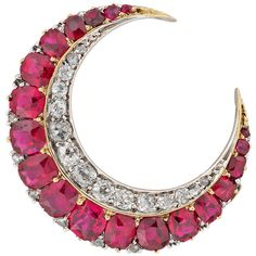 Victorian Ruby Diamond Crescent Brooch. A Victorian ruby and diamond crescent brooch, with one row of cushion-cut graduating rubies estimated to weigh approximately 3 carats and a row of graduating old brilliant-cut diamonds weighing approximately half a carat, all set in silver to a yellow gold mount with brooch fitting, circa 1880, gross weight 5.4 grams, ARV.