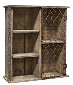 """Aged wood with multiple cubbies for display. The 2 larger cubbies have chicken wire attached to the front so you can use the wire to hang items or place items behind the wire front. Measures 13"""" high"""