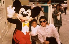 """♥ Michael Jackson ♥ & Emmanuel Lewis & Mickey Mouse :)  The lady walking by looks like """"nah, that can't be Michael Jackson..."""" lol"""