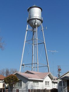 Water Tower in Gustine, CA by Richard Johnstone