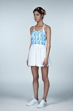 The Flora Wild tennis dress is a one-of-a kind tennis dress. Made from an exclusive hand-drawn textile design, this tennis dress is perfect for your next tennis match since it stands out from miles away! Tennis Dress, Tennis Clothes, Tennis Fashion, Blue Fashion, Tennis Match, Standing Poses, Ladies Of London, Flowy Skirt, Independent Women