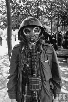 Ralph Crane - A anti-election demonstrator wearing a WWII Russian helmet and gas mask during demonstrations in front of the City Hall, San Francisco, November 6, 1968.