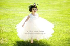 Check out the flower headdress!  Isn't it lovely?  This tutu dress is made with ivory and champagne tulle and has a ivory crochet top, it is adorned with two rows of ivory chiffton rose